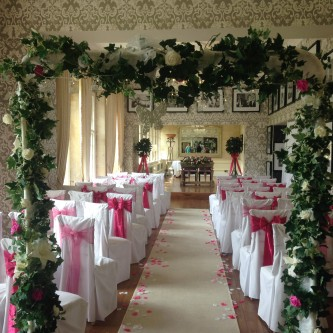Wedding arch with lights flowers everything covered wedding arch hire junglespirit Images