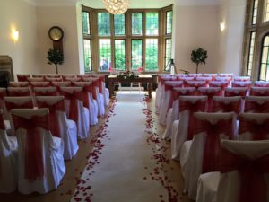 chair covers, aisle runner, petals & bays Coombe Lodge