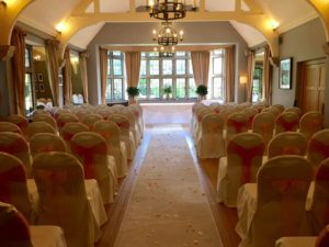 Chair Covers Peach & Coral Hare & Hounds Hotel