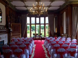 Manor by the Lake red sashes aisle petals