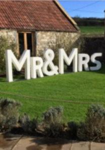 Mr & Mrs sign Priston Mill