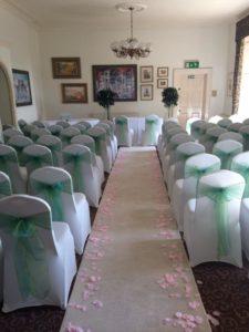 The Grange heather green sash aisle runner pink petals