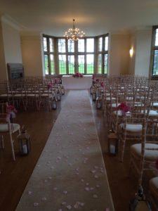 aisle runner, petals & lanterns Coombe Lodge