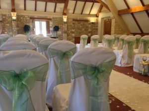 chair covers lanterns bays and aisle runner Castle Combe Manor House